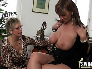 Busty lesbians have many toys for their smooth mature pussies