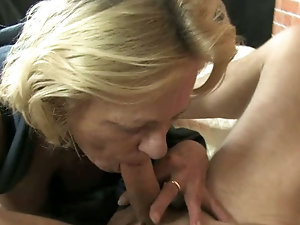 Busty mature lady sucks a dick
