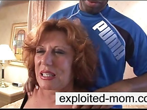 Hot mature loves going down on cock