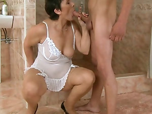Pretty mature brunette suck his friend cock until a huge